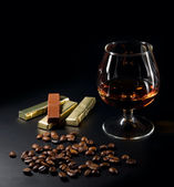 Cognac and coffe beans — Stock Photo