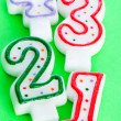 Birthday candles against colourful background — Stock Photo #4201520