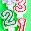 Foto Stock: Birthday candles against colourful background