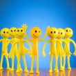 Royalty-Free Stock Photo: Leadership concept with smilies against gradient background