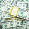 Stack of dollars on money background — Stock Photo #4206546