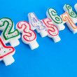 Stock Photo: Birthday candles against colourful background