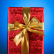 Gift box against gradient background — Stock Photo