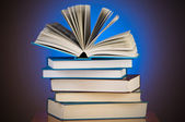 Stack of books against gradient background — Stock Photo