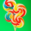 Colourful lollipop against the colourful background - Stock Photo