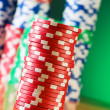 Stack of casino chips against gradient background — Stock Photo #4213731