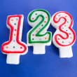 Birthday candles against colourful background — 图库照片