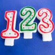 Birthday candles against colourful background — Stock Photo