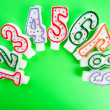 Stockfoto: Birthday candles against colourful background