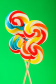 Colourful lollipop against the colourful background — Stock Photo