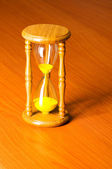 Time concept with hourglass against background — Stock Photo
