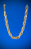 Golden chain isolated on the white background — Стоковое фото