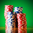 Stack of casino chips against gradient background — Stock Photo