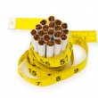 Smoking concept with measuring tape and cigarettes — Stock Photo #4349146