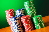 Stack of casino chips against gradient background — 图库照片