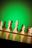 Chess concept with pieces on the board — Stock Photo