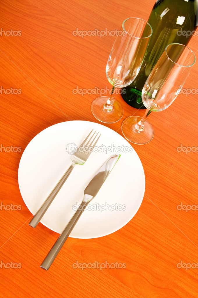 Bottle of wine on the wooden table — Stock Photo #4349343
