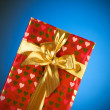Stock Photo: Gift box against gradient background