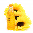 Three sunflowers and bottle of oil isolated on white — Stock Photo