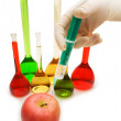 Hand injecting chemical into apple isolated on white - Foto de Stock