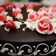 Close up of cake with decoration flowers — Stock Photo