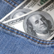 Stock Photo: Hundred dollar bank note in jeans pocket