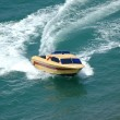Motor boat making a turn in the sea - Stok fotoğraf