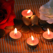 Aromatic candles and  pebbles for spa session - Photo