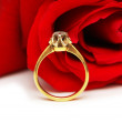 Stock Photo: Diamond ring against the bouquet of red roses