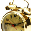 Golden alarm clock isolated on the white — Stock Photo
