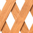 Wooden trellis with rhomb shaped holes — Stock Photo