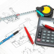 Design drawings, calculator, pens and measuring tape — Stock Photo