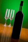 Wine against colour gradient background — Stock Photo