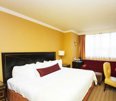 Double bed in the hotel room — Stock Photo