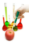 Hand injecting chemical into apple isolated on white — Stock Photo