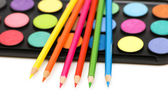 Palette and pencils isolated on the white — Stock Photo