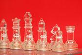 Varias piezas de ajedrez contra el fondo rojo — Foto de Stock