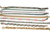 Various bracelets isolated on the white background — 图库照片