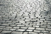 Cobbles on the street - can be used as background — Stock Photo