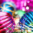 Colourful christmas decoration on a shiny background - Stock Photo