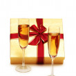 Giftbox and champagne isolated on the white — Stock Photo