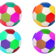 Footballs of four different colors isolated on white — Stock Photo