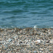 Water and small pebbles at the beach — Stock Photo