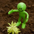 Stock Photo: Gardening concept - Smilie looking after green seedlings