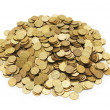 Pile of golden coins isolated on white — 图库照片