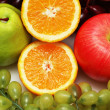 Half cut orange and other colourful fruits - Stock Photo
