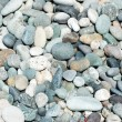 Lots of small pebbles on the beach — Stock Photo #4364192