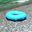 Stock Photo: Ring buoy on beach in summer