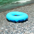 Ring buoy on beach in summer — Stock Photo #4364246
