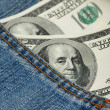 Hundred dollar bank note in the jeans pocket — Stock Photo